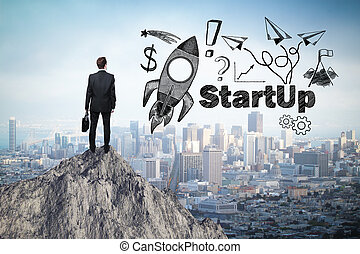 Start up concept with rocket ship sketch and businessman...