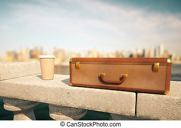 Coffee cup and suitcase - Clouseup of closed suitcase and...