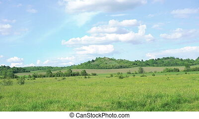 Background of green mountains, grass and sky