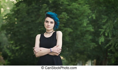 portrait of an attractive punk girl with perfect fair skin....