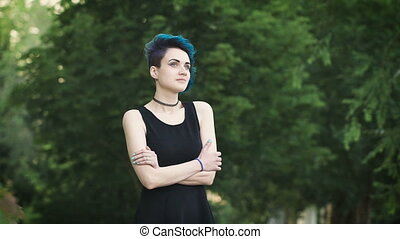 Portrait of a young glamorous girl. She has blue hair, it...