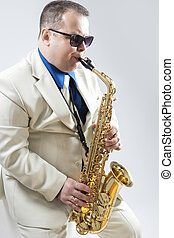Expressive Stylish Caucasian Saxophone Player Performing in...