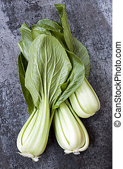 Bok Choi Top View over Dark Slate - Bok choy, top view over...