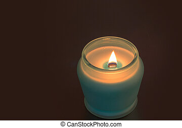 Candle glows in the dark - A candle glows in the dark,...