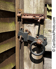 Gate hinge - Rusty old iron handle and bolt on timber garden...