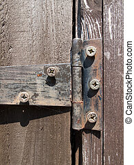 Gate hinge - Rusty old iron hinge on timber garden shed door