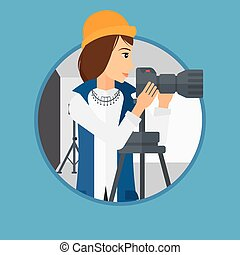 Photographer working with camera on tripod. - Photographer...