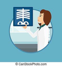 Doctor examining radiograph - Doctor examining a radiograph...