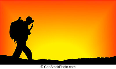 Soldier walking in front of sun rising