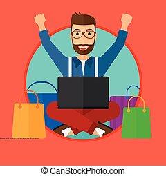 Man shopping online using his laptop.