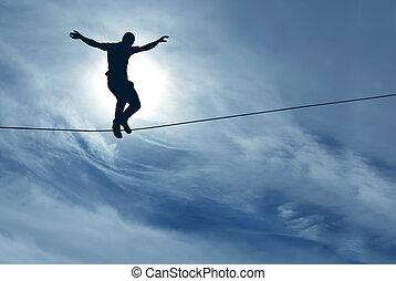 Man balancing on the rope concept of challenge and risk...