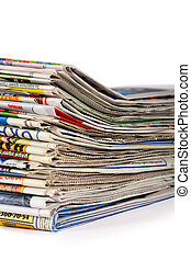 A pile of newspapers isolated on a white background