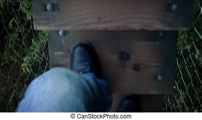 POV Walking On Forest Walkway - POV legs walking on wooden...