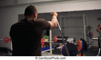 Man works with simulator in the gym 4k