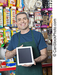 Salesman Showing Tablet Computer With Blank Screen In Pet...