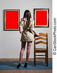 Woman in gallery - Woman standing inside a gallery infront...