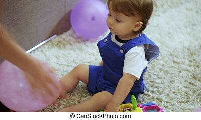 Baby on floor with toys - Sitting on floor baby playing with...