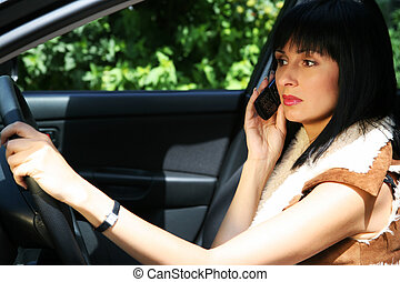 Pretty girl in the car - Girl with the phone in the...