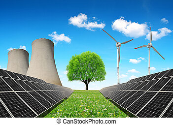Energy resources concept - Solar panels before a nuclear...
