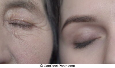 Close up eyes of grandmother and granddaughter. Cuddling....