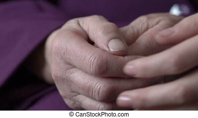 Old woman young girl hold hand wrinkle skin close up. Slowly