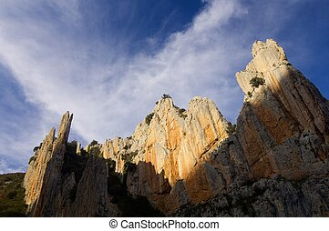 rocky needles and cloudy sky in Spain