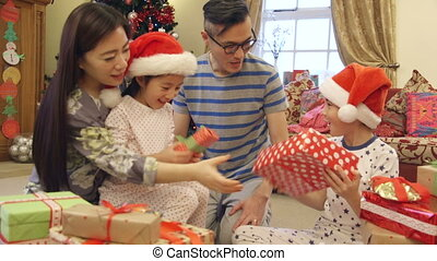 What could it be? - Chinese family on Christmas morning. The...