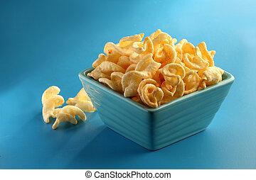 Cheesy curls - Cheesy curl snacks in a blue bowl