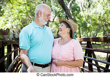 Flirty Senior Couple Outdoors - Beautiful senior couple...