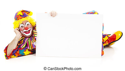 Relaxed Clown with Sign - Clown lying on the floor holding a...