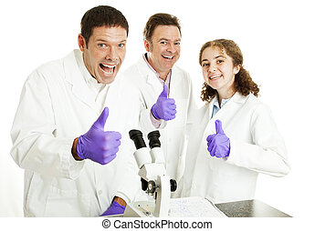 Thumbs Up For Science - Three enthusiastic scientists or...