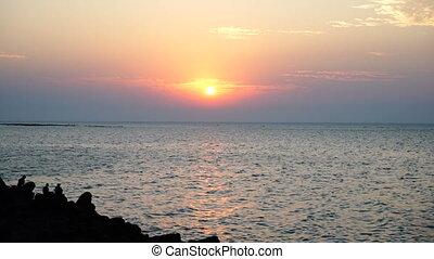 Sea. Sun. Mumbai. - Sunset time at the rocky beach.