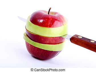 Apple slices - Knife cutting an apple into slices. Image of...