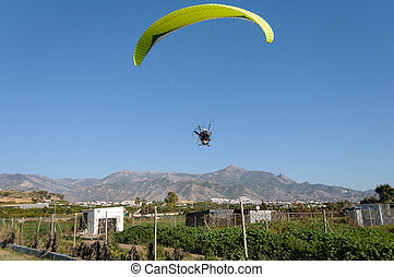 Yellow motor- driven paraglider - A yellow motor- driven...