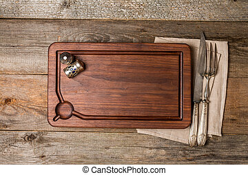 Chopping cutting board, seasonings and meat fork  knife