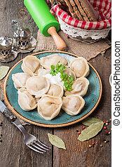 Homemade Meat Dumplings - russian pelmeni with fresh parsley...