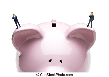 Small business savings - Businessman figurines placed on a...