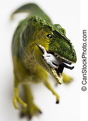 Hungry for business - Dinosaur figurine eating a businessman...