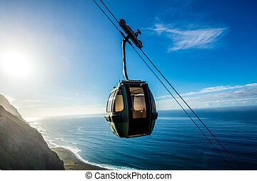 Cable car going down along the cliffs, Achadas da Cruz,...