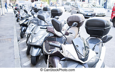 Lot of motor scooters parked in a row - Motorbike,...