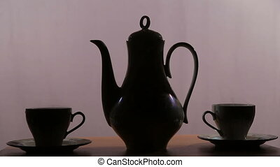 Tea set on the table - Porcelain tea set on an purple...