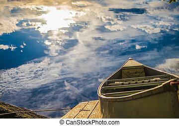 row boat on sky