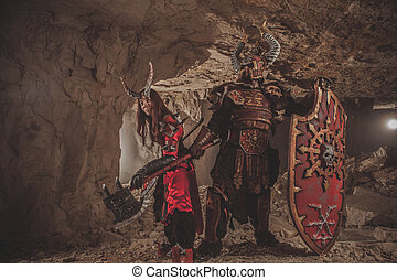 Couple of knights in armor with axes. Catacombs on the...