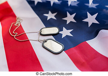 close up of american flag and military badges - military...