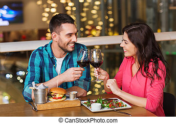 happy couple dining and drink wine at restaurant - leisure,...