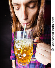 Young man drinking pint - Drinking alcohol liquor relax...