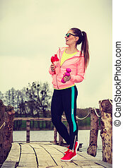 Young sports woman taking break after workout - Sport and...