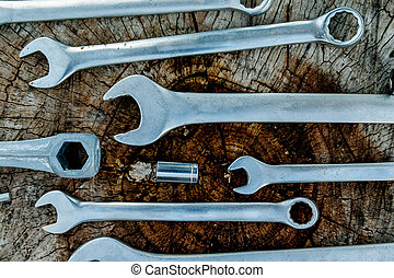 Tools, instrument for repairing on the wooden background, close up, top view. Bicycle repair.