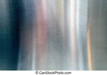 Polished shiny steel metal surface with reflections and glare
