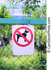 Sign prohibiting dog walking, no dogs sing vertical location